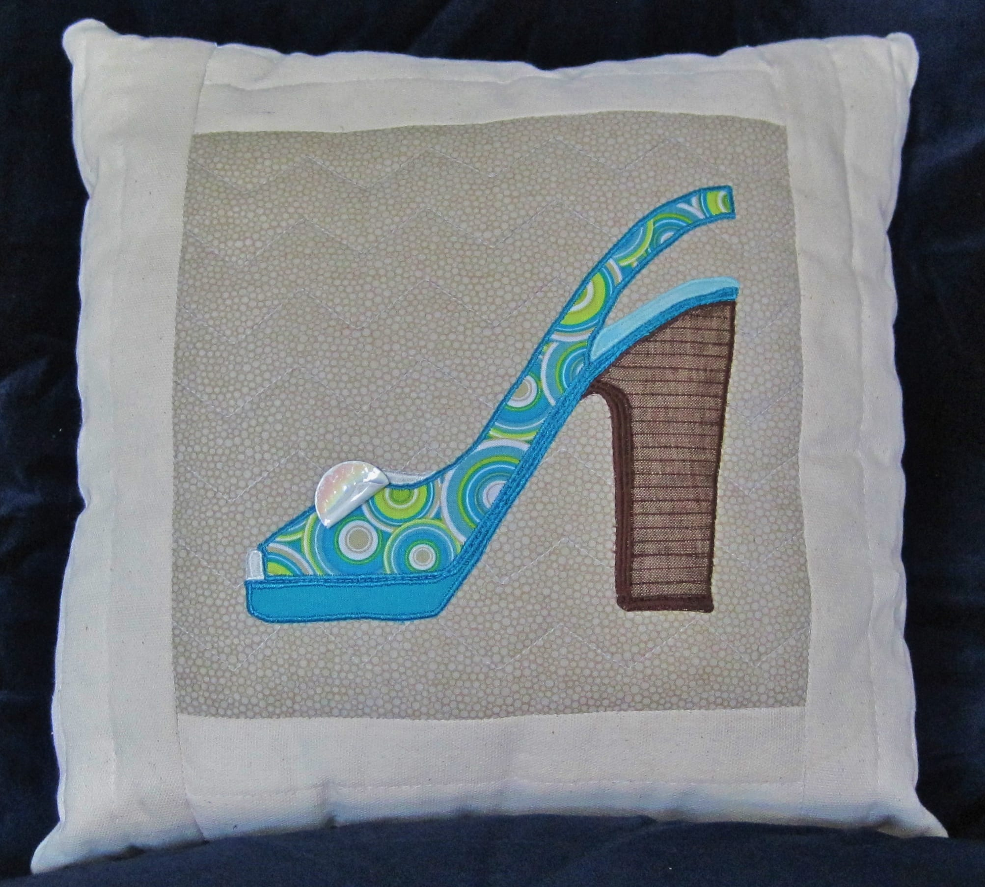 Fashionista Shoe Applique Pattern - Janice Holden Designs on crochet pillow ideas, fall pillow ideas, wuilted pillow ideas, sewing pillow ideas, needle felted pillow ideas, chenille pillow ideas, patchwork pillow ideas, diy pillow ideas, trapunto pillow ideas, easter pillow ideas, christmas pillow ideas, button pillow ideas, handmade pillow ideas,